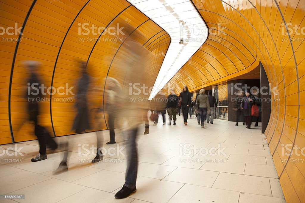 People passing by on modern orange subway stock photo