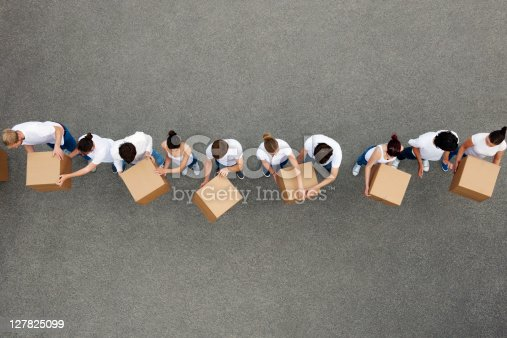 istock People passing cardboard boxes 127825099