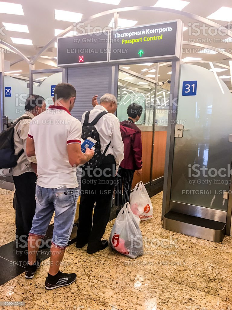 People passing Passport control before departure, Moscow stock photo