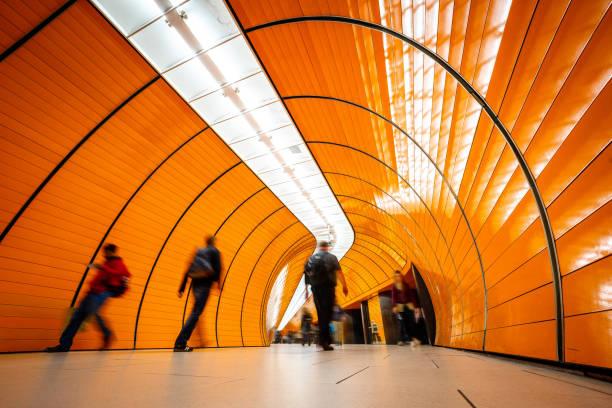 personer som passerar gångtunnel - munich train station bildbanksfoton och bilder