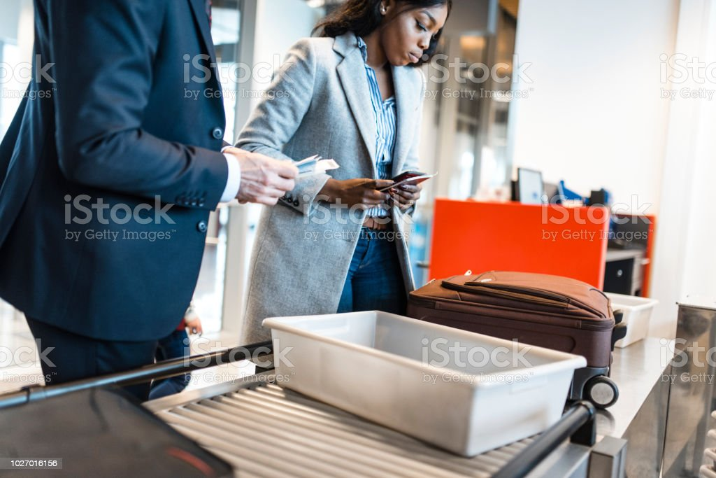 People passing security check on the airport stock photo