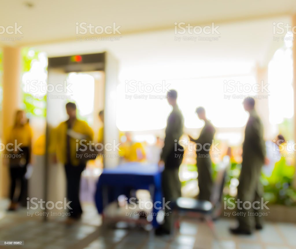 people passing weapon inspection machine door and policemen stock photo