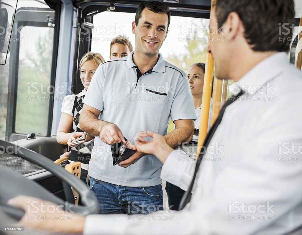 People paying bus fares. stock photo