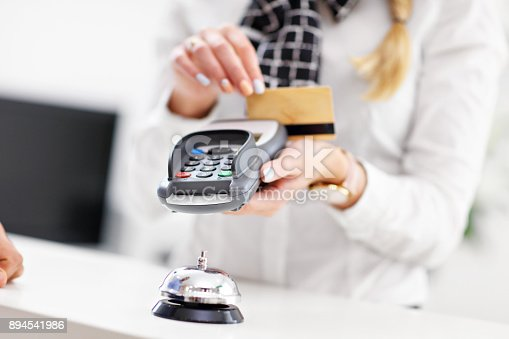 istock People paying in hotel reception 894541986