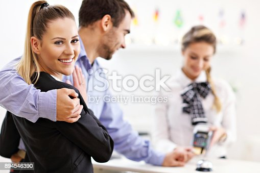 istock People paying in hotel reception 894546390
