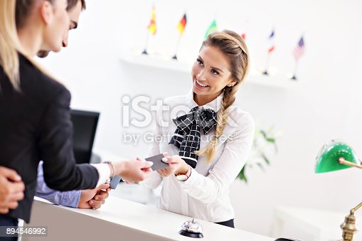 istock People paying in hotel reception 894546992