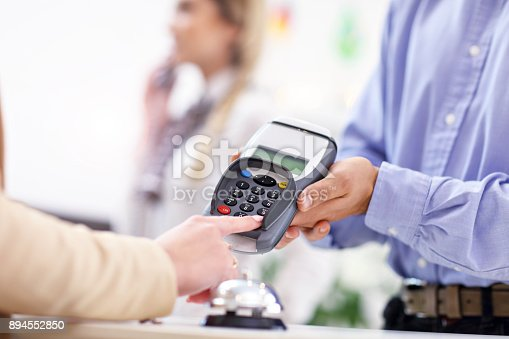 istock People paying in hotel reception 894552850