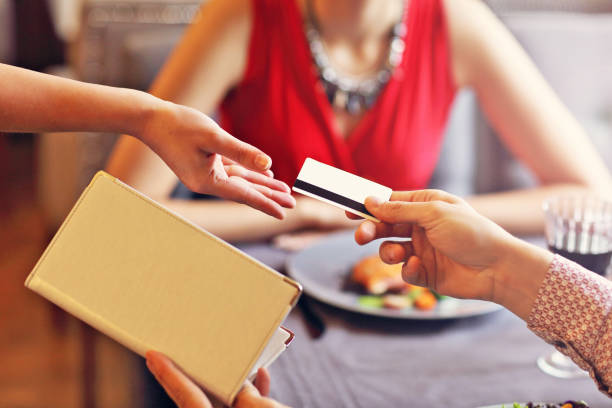 people paying in restaurant by credit card reader - dinner date stock photos and pictures