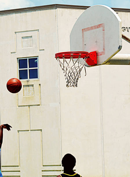 people people playing basketball on a hot summer day in galveston tx - deign stock pictures, royalty-free photos & images