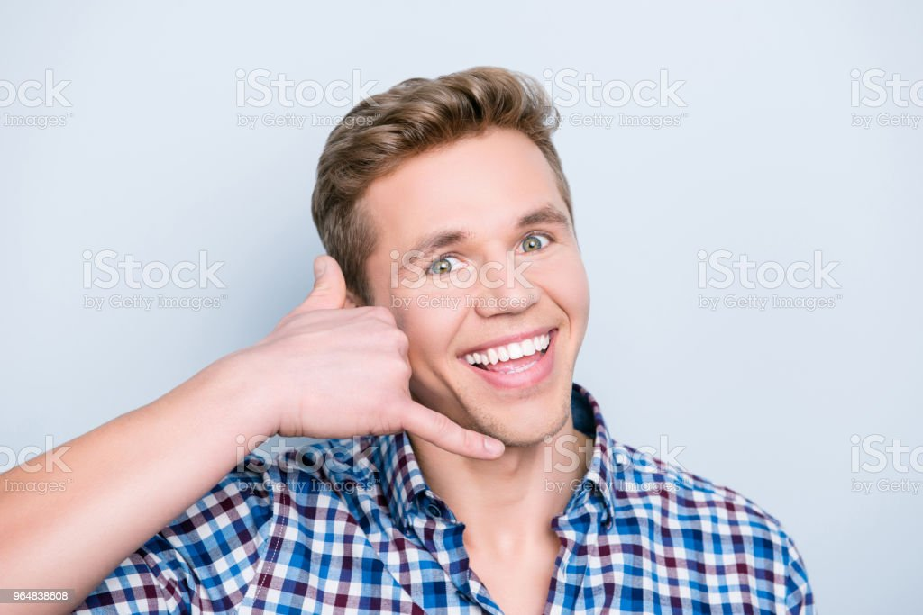 People person leisure manager call center help listen concept. Close up portrait of excited surprised astonished wondered amazed handsome guy making call me gesture isolated on gray background royalty-free stock photo