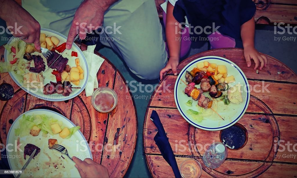 people photographed from above while eating the meal with vintag stock photo