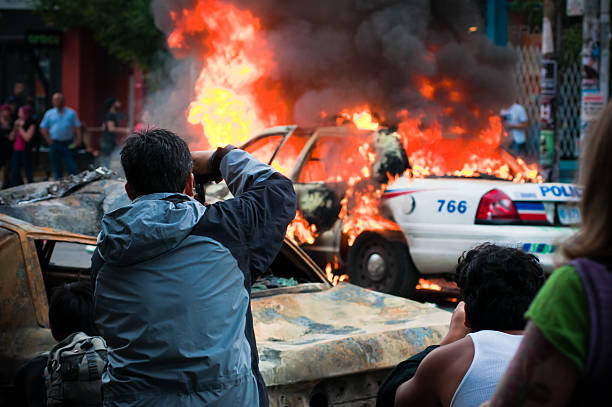 People photographing a fire  riot stock pictures, royalty-free photos & images