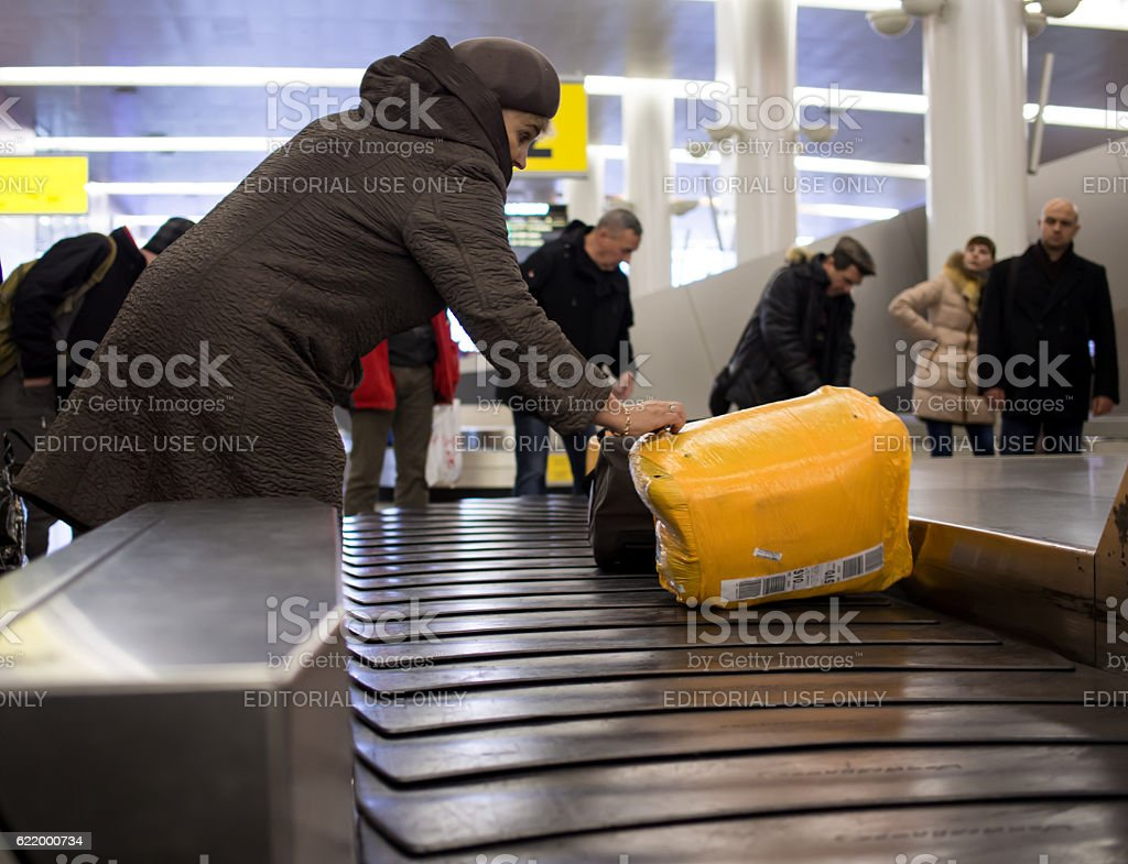 People pick up luggage from the conveyor belt conveyor stock photo