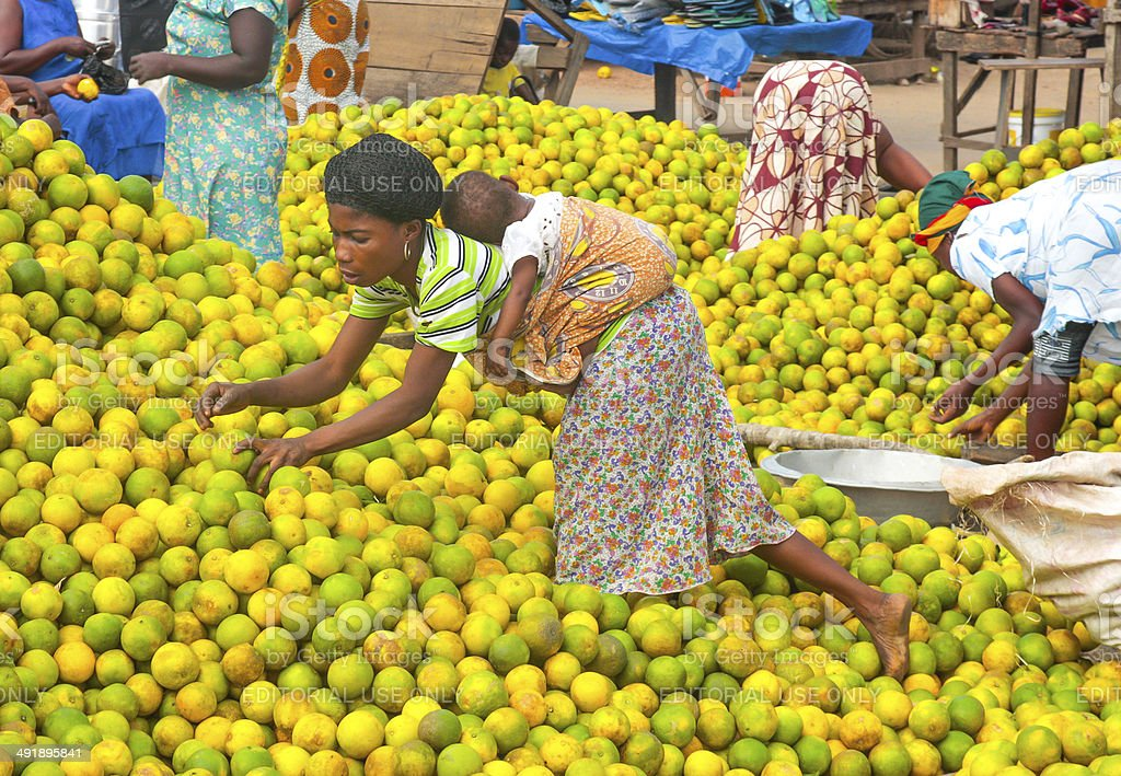 People picking oranges at the market in Ghana, Africa stock photo