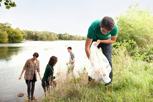 People picking up garbage in park  environmental cleanup stock pictures, royalty-free photos & images
