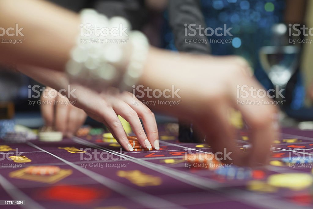People placing bets stock photo