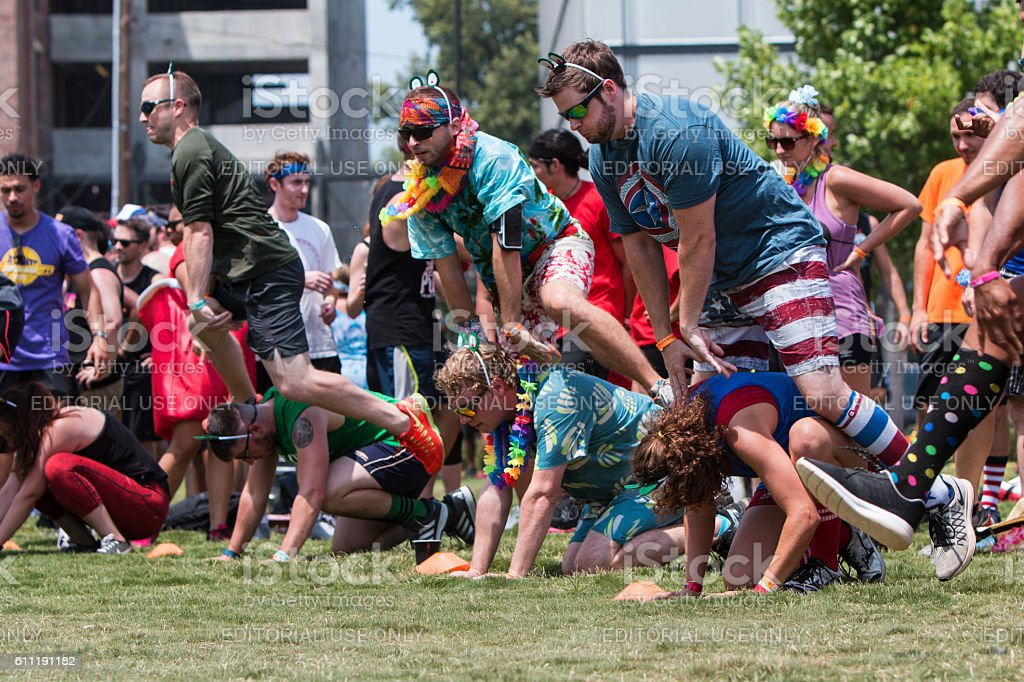 People Play Leap Frog At Atlanta Field Day Event stock photo