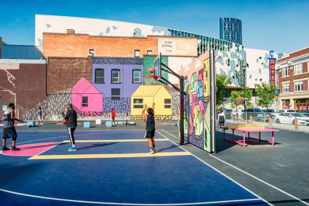 People play on basketball court downtown Calgary Alberta Canada stock photo
