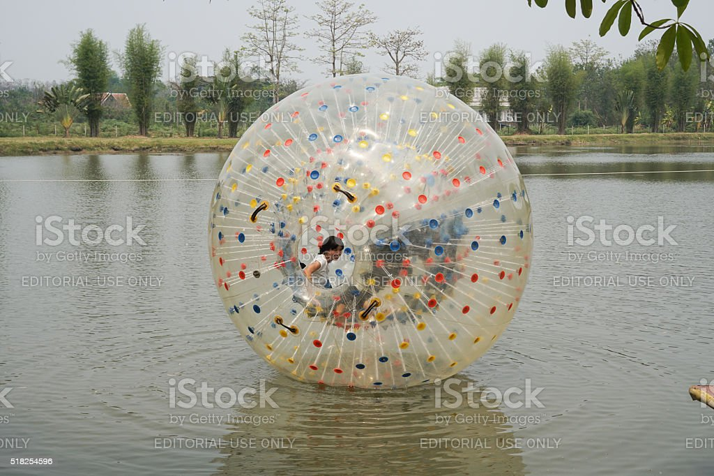 People play zorb inflatable ball on the pond stock photo