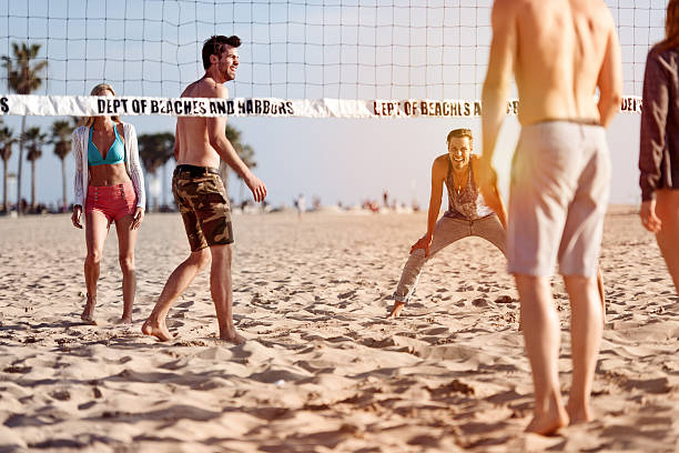 People playing beach volleyball stock photo