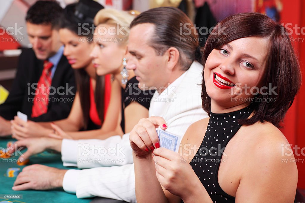 People playing blackjack in casino. royalty-free stock photo