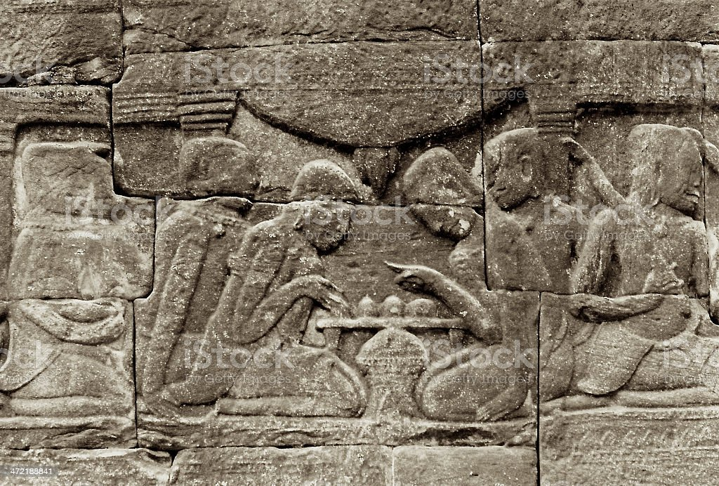 People Playing Board Game at Bayon Temple stock photo