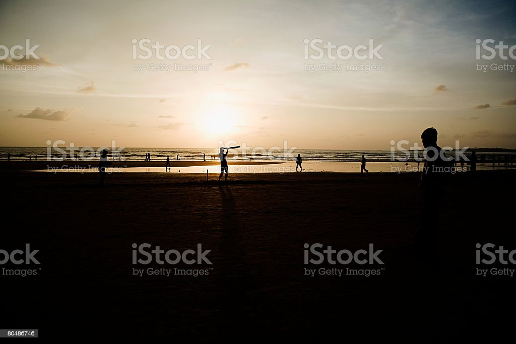 People playing cricket on mumbai beach stock photo