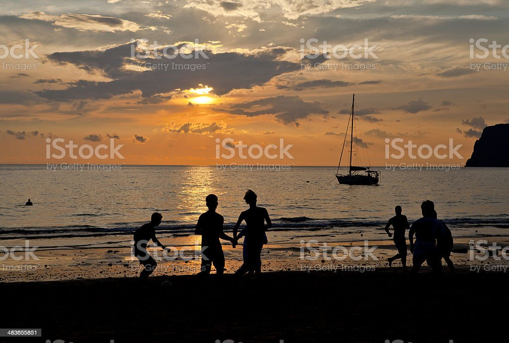 People playing football on silhouette scene. royalty-free stock photo