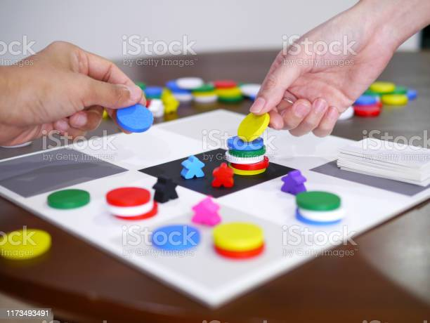 People playing fun board game on wooden table top selected focus picture id1173493491?b=1&k=6&m=1173493491&s=612x612&h=ykwyzowvpwf281mdlndn8muegeermhyiufrtgcpijdg=