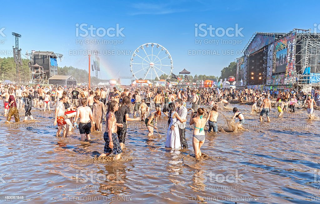 People playing in mud. stock photo