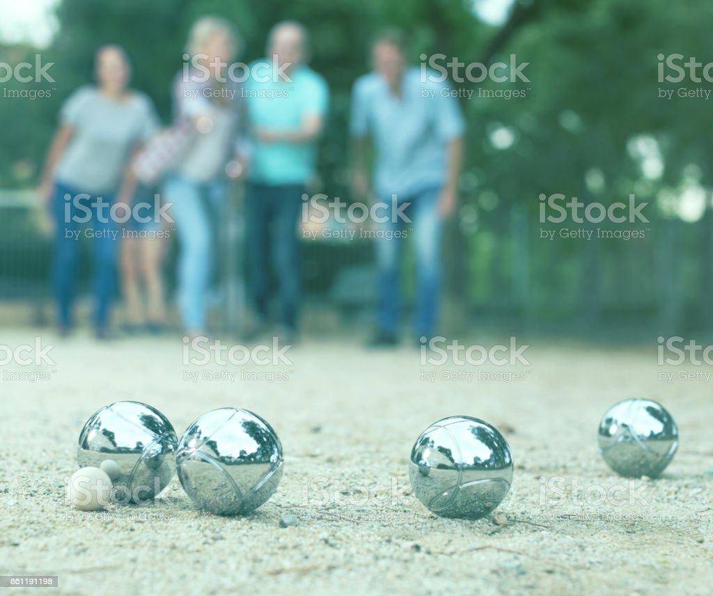people playing petanque at leisure stock photo