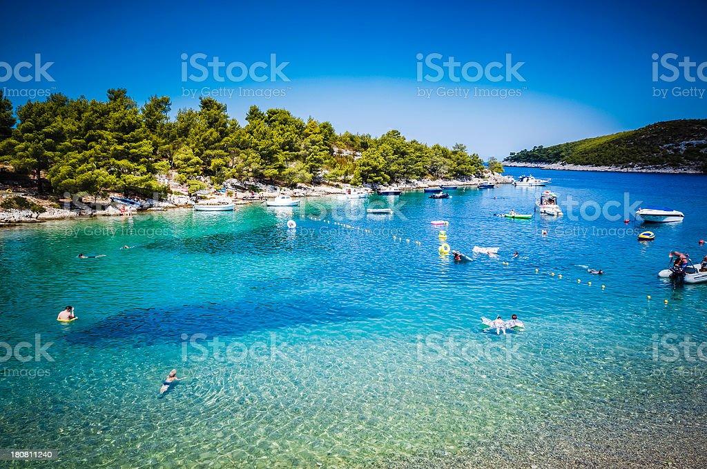 People playing, swimming at sea, bay, Summer Resort, Hvar, Croatia stock photo