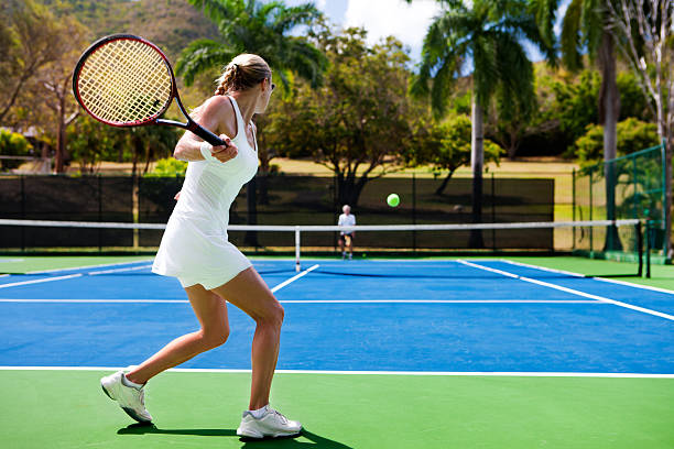 people playing tennis in tropics - tennis stock pictures, royalty-free photos & images