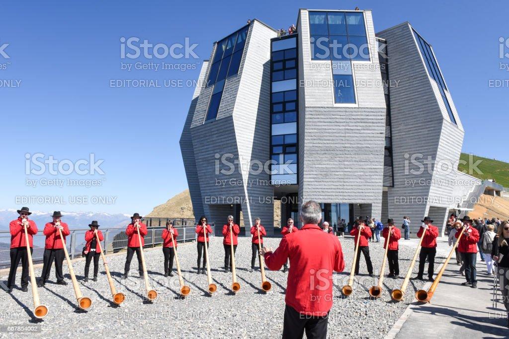 People playing the alphorn at Mount Generoso on Switzerland stock photo