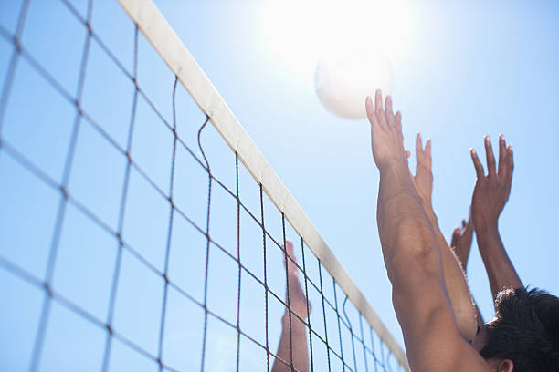 People playing volleyball stock photo