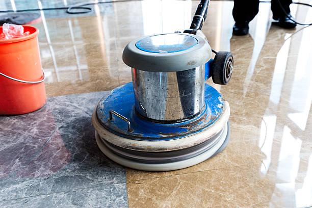 people polishes floor indoors stock photo