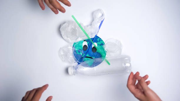 people polluting earth with plastic garbage, ecological problems, stop motion - stop motion stock photos and pictures