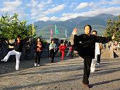 Dali, China - October 6, 2014: People practice tai chi at Dali ancient town in Yunnan province of China.
