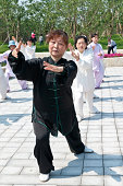 Hangzhou,China - May 1,2014: people practicing tai chi in hangzhou park , on May 1, 2014, in hangzhou, China.Tai Chi Chuan means Supreme Ultimate Fist, it is a martial art practiced both for self defense and health.