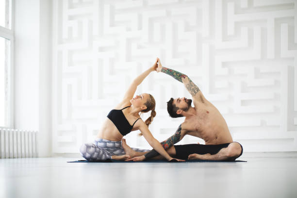 people practicing yoga stock photo