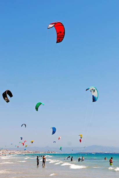 People practising KiteSurfing at Tarifa beach in South Spain stock photo