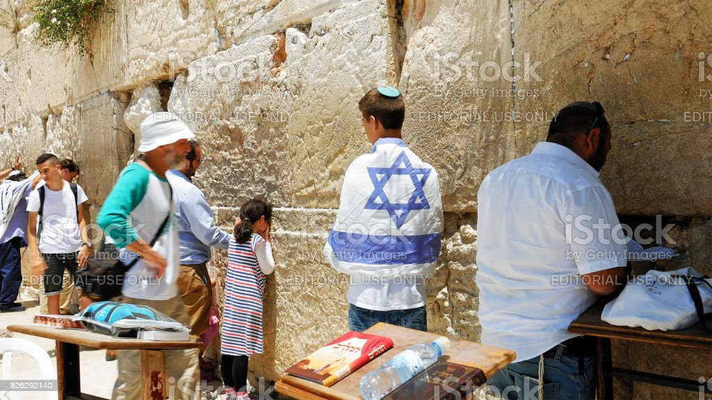 People pray at the Western Wall in Jerusalem stock photo