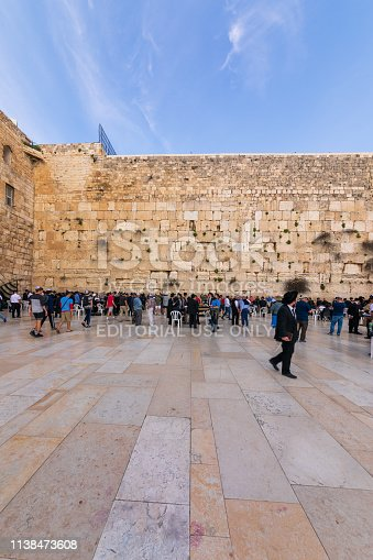 Jerusalem, Israel - Mar 20, 2019: People pray near Wailing Wall in Jerusalem