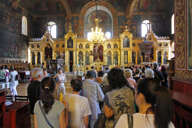 People pray on a holy mass in St. Sedmochislenitsi church in Sofia, Bulgaria on august 15, 2012. stock photo
