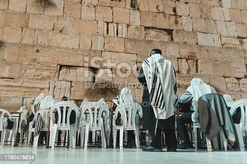 People praying to their religion at the Wailing Wall or Kotel in historic old city of Jeruslam