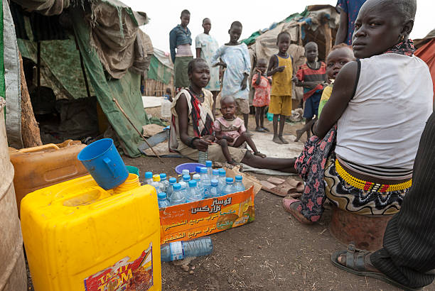 people prepare collect water in refugee camp, juba, south sudan. - sudan stock photos and pictures