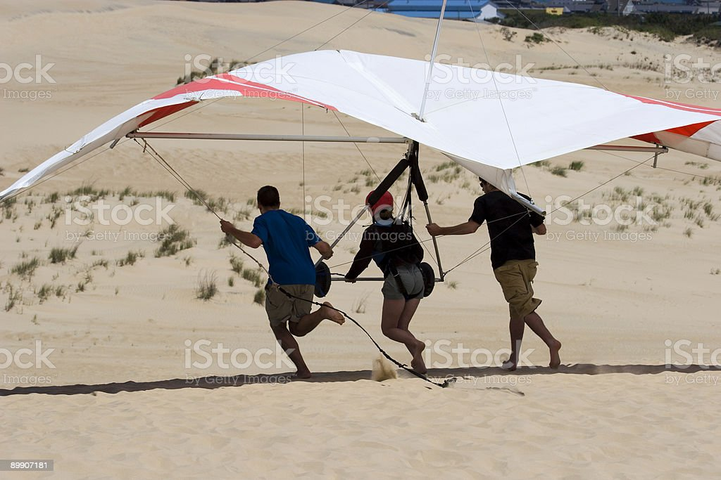 People preparing to take off for hang gliding royalty-free stock photo