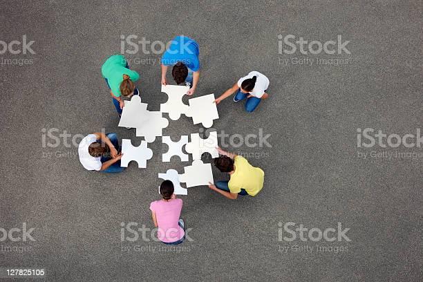 People putting together jigsaw puzzle picture id127825105?b=1&k=6&m=127825105&s=612x612&h=9w2pkrhmztjqkp3cvqkcyxdmhtpfzwt3wyoh46sed6k=