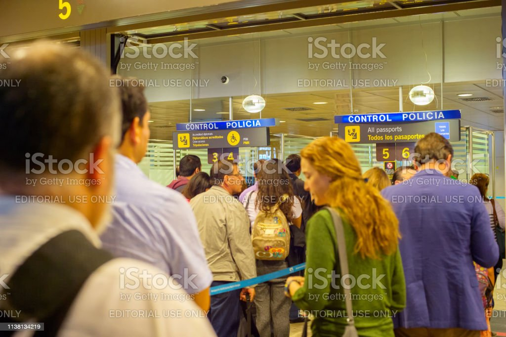 People queue on passport control at arrival, Madrid airport, Spain