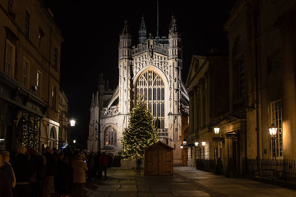 People queue for Christmas Midnigh Bath, United Kingdom - December 24, 2016: People queue for Christmas Midnigh bath abbey stock pictures, royalty-free photos & images